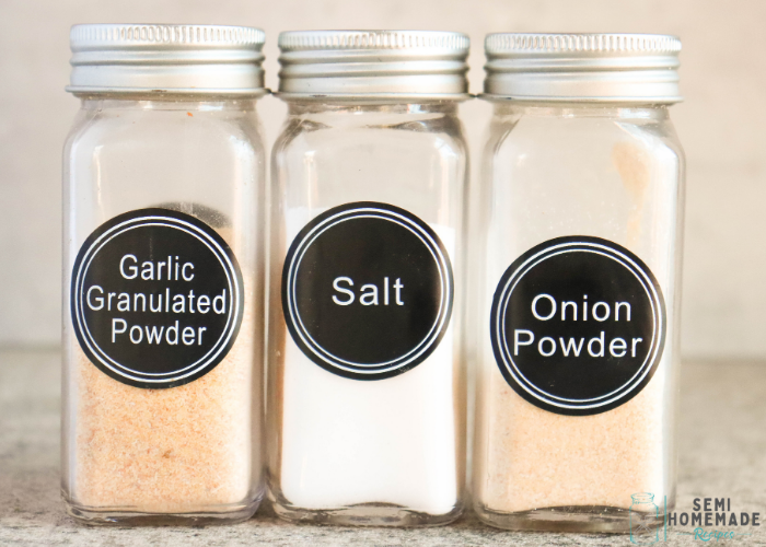Bottles of Garlic Powder, salt and onion powder in a row