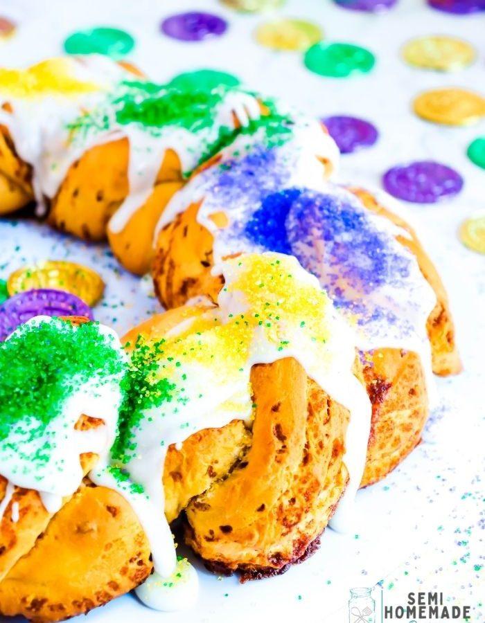 Adding Mardi Gras Colored Sanding Sugars to Cinnamon Roll King Cake