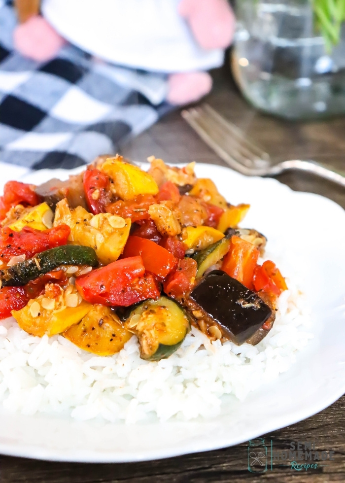 Easy Skillet Ratatouille over rice on a white plate (1)