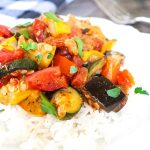 Easy Skillet Ratatouille over rice on a white plate
