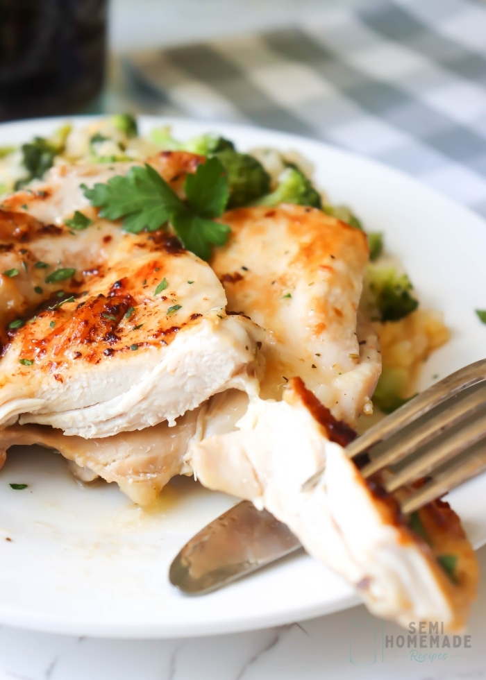 sliced Easy Herb Garlic Chicken Thighs on a white plate