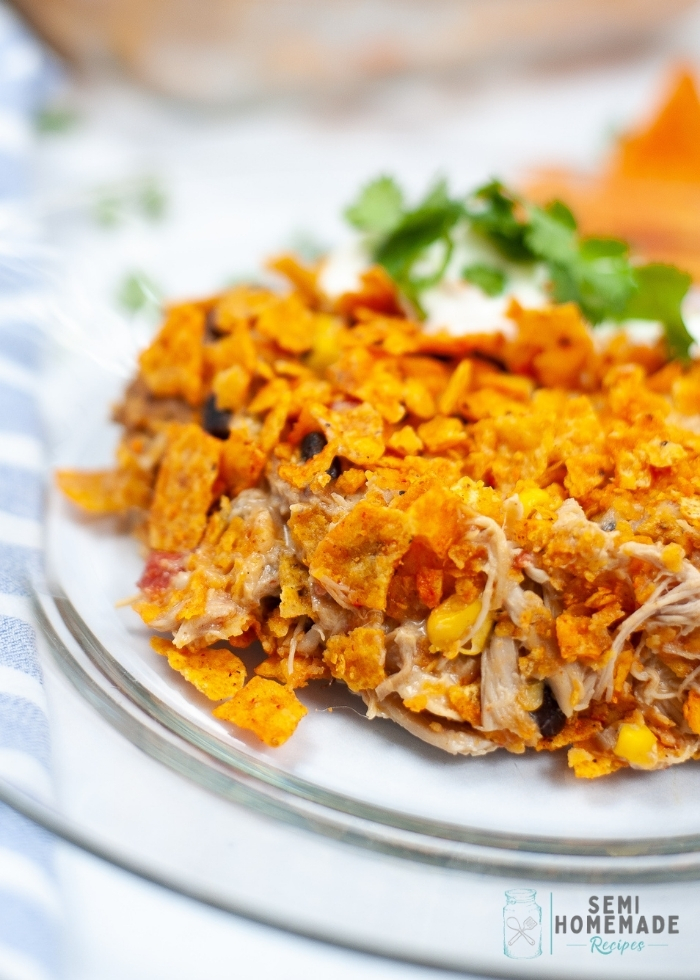 This super easy Dorito Casserole is made form layers of Nacho Cheese Doritos chips, beans, corn, chicken and a few other ingredients for a great weeknight meal!