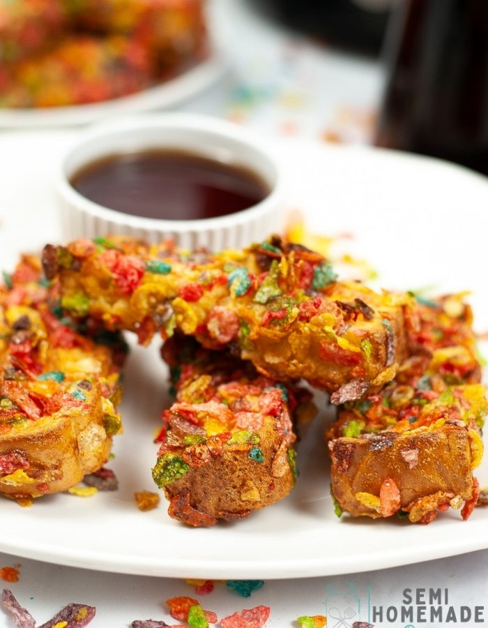 Air Fryer Fruity Pebbles French Toast Sticks on white plate with syrup