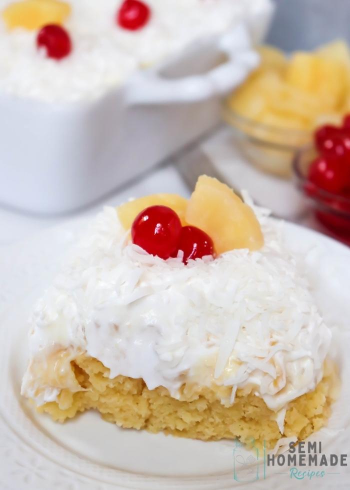 PINA COLADA POKE CAKE on white plate