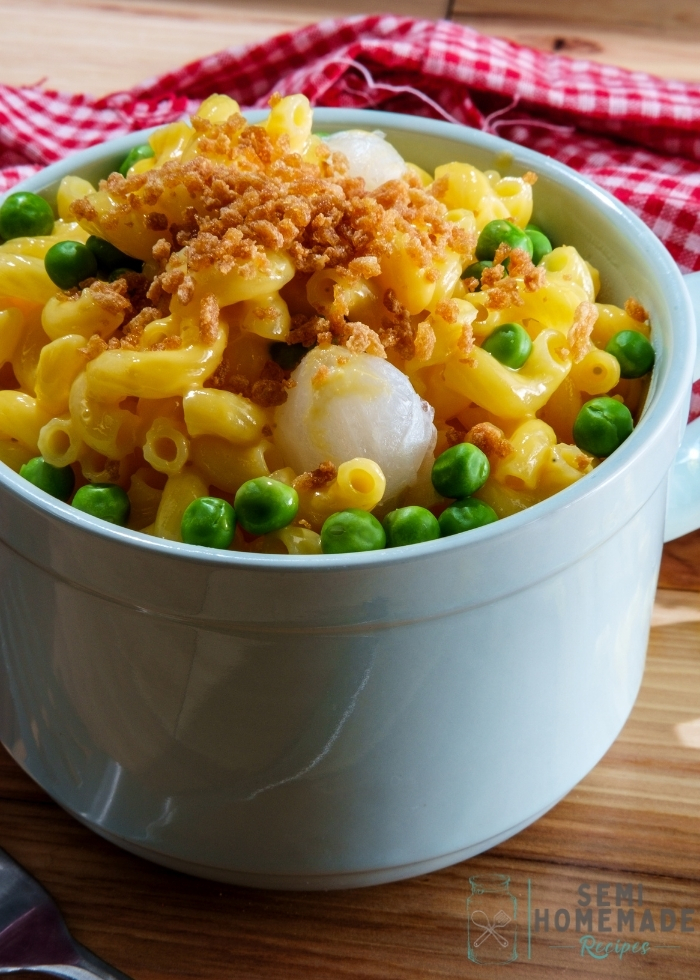 boxed mac and cheese with peas and pearl onions