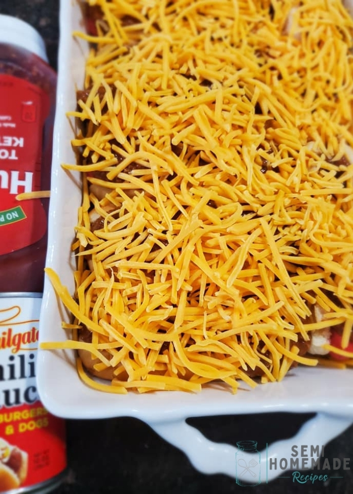 hot dog buns with franks and chili and cheese