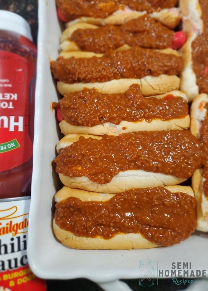 hot dog buns with franks and chili