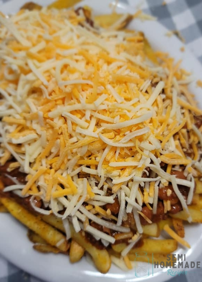chilicheese fries on white plate before melting cheese