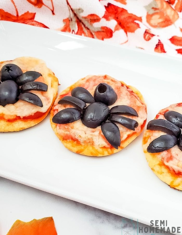 Mini Spider Pizza Bites are made with refrigerated crescent rolls, pizza sauce, shredded mozzarella cheese and black olive spiders!